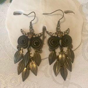 """""""Owl"""" design drop earrings."""